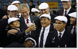 President George W. Bus shares a moment with members of the U.S. Olympic team Friday, Aug. 8, 2008, in Beijing prior to Opening Ceremony of the 2008 Summer Olympic Games. White House photo by Eric Draper
