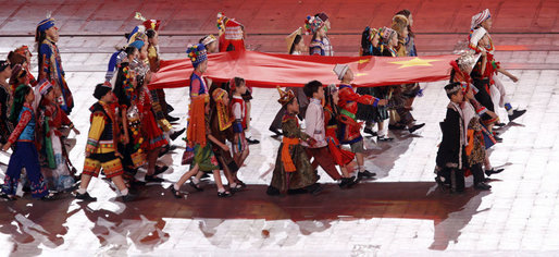 Young performers carry a Chinese flag into National Stadium Friday Aug.8, 2008, during the Opening Ceremonies of the 2008 Summer Olympic Games in Beijing. White House photo by Eric Draper