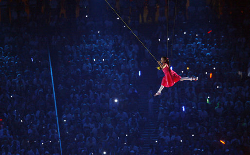 A young performer is suspended through the air during the Opening Ceremonies of the 2008 Summer Olympic Games Friday, Aug. 8, 2008, at the National Stadium in Beijing. White House photo by Eric Draper