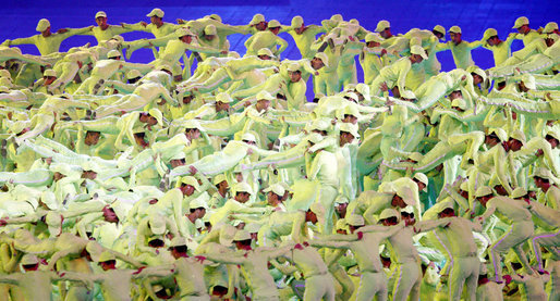 Acrobats perform in bright green costumes at National Stadium Friday, Aug. 9, 2008, during the Opening Ceremonies of the 2008 Summer Olympic Games in Beijing. White House photo by Eric Draper