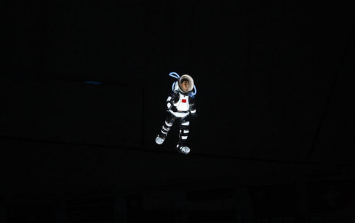 An aerial performance artist in an astronaut costume glides above National Stadium Friday evening, Aug. 8, 2008 in Beijing, during the Opening Ceremonies of the 2008 Summer Olympics. White House photo by Eric Draper