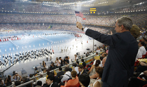 "President George W. Bush and Mrs. Laura Bush acknowledge the entrance of the U.S. athletes into China's National Stadium in Beijing, Friday, Aug. 8, 2008, for the Opening Ceremonies of the 2008 Summer Olympics. The President called the event ""spectacular and lots of fun."" White House photo by Eric Draper"