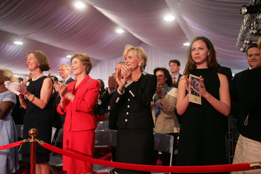 Mrs. Laura Bush stands with Mrs. Sarah Randt, spouse of U.S. Ambassador to China Sandy Randt, left, Mrs. Anne Johnson, Director of Art in Embassies Program, and Ms. Barbara Bush during applause for President George W. Bush Friday, Aug. 8, 2008, at the dedication ceremony for the U.S. Embassy in Beijing. White House photo by Shealah Craighead