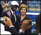 Mrs. Laura Bush with U.S. Flag Bearer Lopez Lomong as she greets members of the U.S. Summer Olympic Team at the Fencing Hall in Beijing on August 8, 2008. Mr. Lomong is a survivor of the violence in his native Sudan. He is now a U.S. citizen and was selected by his teammates to lead the U.S. Olympic team into the Olympic National Stadium carrying the United States Flag at the Opening Ceremony, which followed shortly after this picture was taken. White House photo by Shealah Craighead