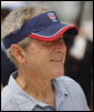 President George W. Bush sports a thank-you note on his visor, courtesy of the U.S. Beach Volleyball team as he watches practice Saturday, Aug. 9, 2008, at Chaoyang Park in Beijing. White House photo by Eric Draper