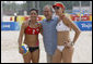"President George W. Bush stands with the U.S. Women's Beach Volleyball team of Misty May-Treanor, left, and Kerri Walsh at the Chaoyang Park practice courts Saturday, Aug. 9, 2008, before their matches at the 2008 Summer Olympics in Beijing. ""What an honor,"" Walsh said. ""He's just a great sports fan and he exudes optimism and pride in his country. I know he's proud of us."" White House photo by Eric Draper"