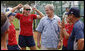 "President George W. Bush visits with the U.S. Women's Softball team Saturday, Aug. 9, 2008, at their Beijing practice field at Fengtai Complex. Calling the team the ""Gold Medal Champs,"" the President said, ""It's good for the world to have girls playing softball and these women are going to show girls how to win."" White House photo by Eric Draper"
