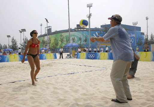 President George W Bush Hits A Volleyball Back To US Womens Beach Team Member Misty May Treanor Left During His Visit The Chaoyang Park