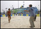 President George W. Bush hits a volleyball back to U.S. Women's Beach Volleyball team member Misty May-Treanor, left, during his visit to the Chaoyang Park practice courts Saturday, Aug. 9, 2008, before the U.S. team began their matches at the 2008 Summer Olympics in Beijing. White House photo by Eric Draper