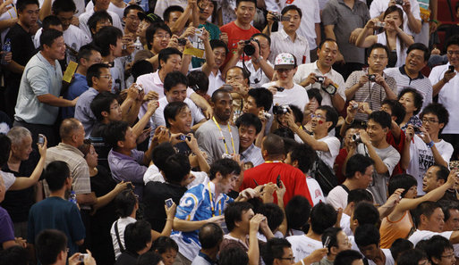 U.S. Olympic Men's Basketball Team member Kobe Bryant is surrounded by fans as he arrives to attend the U.S. Women's Olympic Basketball Team's match Saturday, Aug. 9, 2008, against the Czech Republic team at the Beijing 2008 Summer Olympics Games. White House photo by Eric Draper