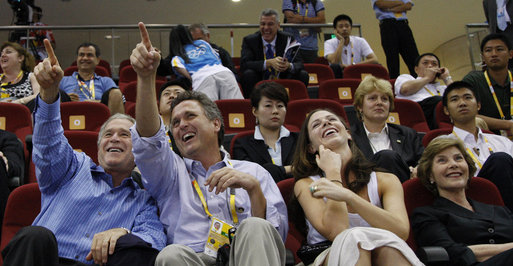 President George W. Bush is joined by his brother, Marvin Bush, daughter, Ms. Barbara Bush and Mrs. Laura Bush as they attend the U.S. Women's Olympic Basketball Team's match Saturday, Aug. 9, 2008, against the Czech Republic team at the Beijing 2008 Summer Olympics Games. White House photo by Eric Draper
