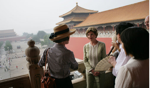 Mrs. Laura Bush listens as Mrs. Sarah Randt, spouse of the U.S. Ambassador to the People's Republic of China, leads a tour of the Forbidden City Friday, Aug. 9, 2008, in Beijing. White House photo by Shealah Craighead