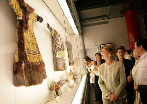 Mrs. Laura Bush closely examines a display at the Exhibition of Imperial Garments and Jewelry Saturday, Aug. 9, 2008, during her tour of the Forbidden City in Beijing. White House photo by Shealah Craighead