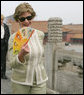 Mrs. Laura Bush finds relief from the Beijing heat in an ornamental fan during a visit Friday, Aug. 9, 2008, to the Forbidden City. White House photo by Shealah Craighead