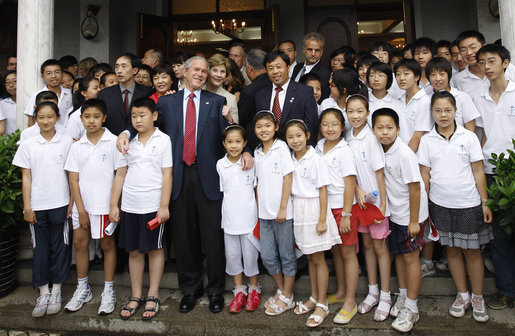 President George W. Bush and Mrs. Laura Bush stand outside the Kuanjie Protestant Christian Church with members of the Kuanjie Summer Vacation School Choir after attending services Sunday, Aug. 10, 2008, in Beijing. White House photo by Eric Draper