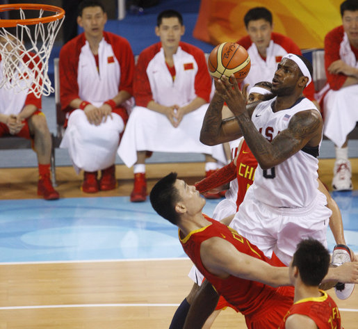 U.S. Olympic Men's Basketball team member LeBron James goes up for shot against China's Yao Ming ...