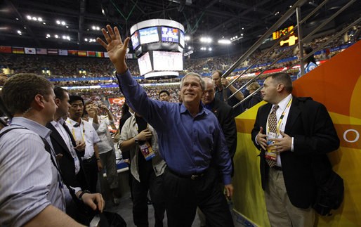 President George W. Bush waves to fans as he arrives Sunday, Aug. 10, 2008 to attend the Group B men's Olympic basketball game between the U.S. and China, at the 2008 Summer Olympic Games in Beijing. White House photo by Eric Draper
