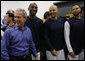 President George W. Bush spends a moment with U.S. Olympic Men's Basketball Team members, from left, Kobe Bryant, Jason Kidd and Deron Williams Sunday, Aug. 10, 2008, during a visit with the team prior to their game against China at the 2008 Summer Olympic Games in Beijing. White House photo by Eric Draper