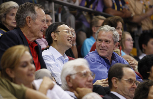 President George W. Bush attends the U.S. Olympic Men's Basketball Team's game against China with his father, former President George H.W. Bush and China's Foreign Minster Yang Jiechi Sunday, Aug. 10, 2008, at the 2008 Summer Olympic Games in Beijing. White House photo by Eric Draper