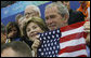 President George W. Bush and Mrs. Laura Bush cheer on the U.S. Olympic swimmers during the Sunday morning competition at the National Aquatics Center in Beijing. White House photo by Eric Draper