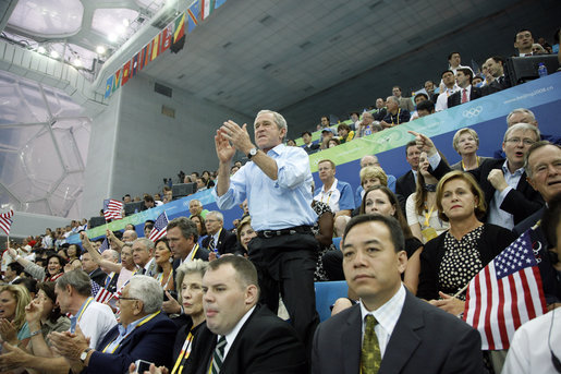 President George W. Bush whistles his support as Michael Phelps swims to his world-record mark in the 400-Meter Individual Medley Sunday, Aug. 10, 2008, at the 2008 Olympic Summer Olympics in Beijing. White House photo by Eric Draper