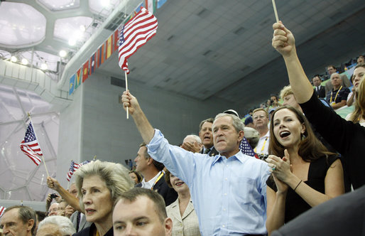 President George W. Bush, Mrs. Laura Bush and daughter Barbara Bush join the fans at the National Aquatics Center as they cheer on U.S. swimmer Michael Phelps as he swam his world-record setting 400-Meter Individual Medley event Sunday, Aug. 10, 2008, in Beijing. White House photo by Eric Draper