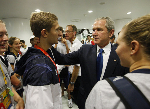 President George W. Bush speaks with U.S. Olympic swimmer and silver medalist Larsen Jensen Sunday, Aug. 10, 2008, at the National Aquatics Center in Beijing. White House photo by Eric Draper
