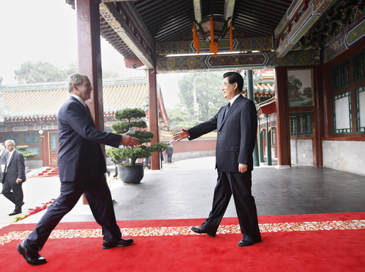 President George W. Bush is welcomed by China's President Hu Jintao upon his arrival Sunday, Aug. 10, 2008 to Zhongnanhai, the Chinese leaders compound in Beijing. White House photo by Eric Draper