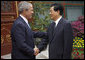 President George W. Bush shakes hands with China's President Hu Jintao following his visit and meeting Sunday, Aug. 10, 2008, with the Chinese leader at Zhongnanhai, the Chinese leaders compound in Beijing. White House photo by Eric Draper