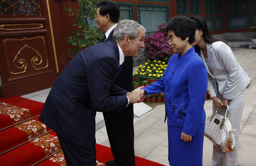 President George W. Bush shakes hands with Madame Liu Yongquig, wife of China's President Hu Jintao, following President Bush's visit and meeting Sunday, Aug. 10, 2008, to Zhongnanhai, the Chinese leaders compound in Beijing. White House photo by Eric Draper