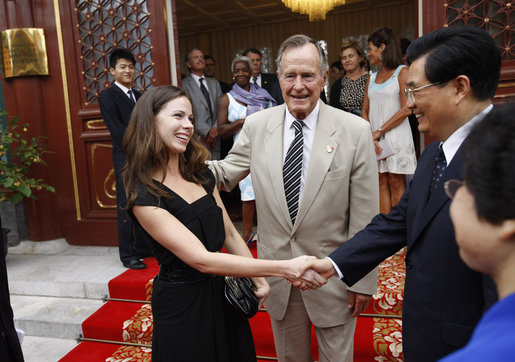 Former President George H. W. Bush introduces his granddaughter, Ms. Barbara Bush, to China's President Hu Jintao Sunday, Aug. 10, 2008, following their visit to Zhongnanhai, the Chinese leaders compound in Beijing. White House photo by Eric Draper