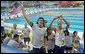 U.S. athletes wave to President George W. Bush and Mrs. Laura Bush after their arrival Sunday, Aug. 10, 2008, to the National Aquatics Center in Beijing, where they viewed the morning session of the swimming competition at the 2008 Summer Olympics. White House photo by Shealah Craighead