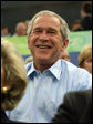 President George W. Bush smiles in response to the waves from the U.S. athletes after arriving Sunday, Aug. 10, 2008, at the National Aquatics Center in Beijing. White House photo by Shealah Craighead