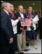 President George W. Bush and former President George H.W. Bush pose for photos with U.S. Olympic swimmers Larsen Jensen, left, and Michael Phelps Sunday, Aug. 10, 2008, at the National Aquatics Center in Beijing. White House photo by Shealah Craighead