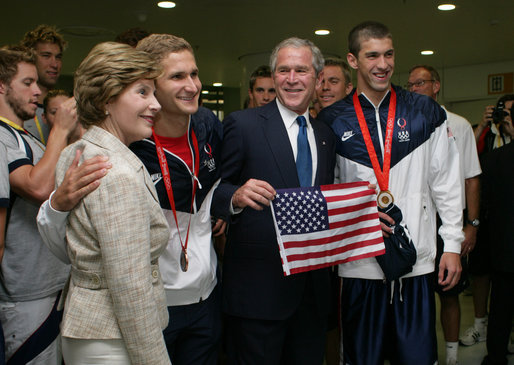 President George W. Bush and Mrs. Laura Bush pose for photos with U.S. Olympic swimmers Larsen Jensen, left, and Michael Phelps Sunday, Aug. 10, 2008, at the National Aquatics Center in Beijing. White House photo by Shealah Craighead
