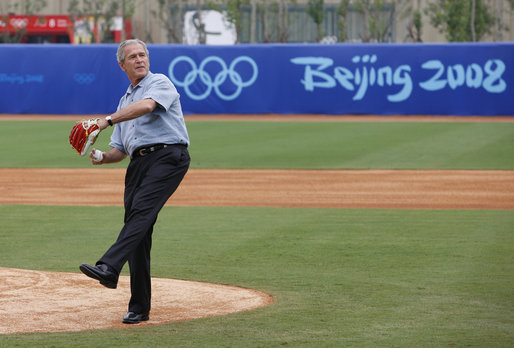 President George W. Bush throws out the first pitch at the Men's Olympic Baseball practice with Team USA and Team China, Monday, Aug. 11, 2008. White House Photo by Eric Draper White House photo by Eric Draper