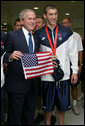 President George W. Bush poses for a photo with U.S. Olympic swimming gold medalist Michael Phelps during his visit Sunday, Aug. 10, 2008 to the National Aquatic Center in Beijing, where Phelps won his first Olympic gold medal in the men's 400 meter individual medley. White House photo by Shealah Craighead