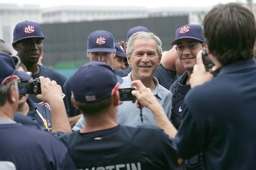 President George W. Bush poses for photos with members of the U.S. Olympic men's baseball team prior to a practice game against the Chinese Olympic men's baseball team Monday, Aug. 11, 2008, at the 2008 Summer Olympic Games in Beijing. White House photo by Chris Greenberg