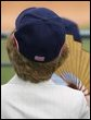 Mrs. Laura Bush wearing a U.S. Olympic baseball team hat watches the U.S. Olympic men's baseball team play a practice game against the Chinese Olympic men's baseball team Monday, Aug. 11, 2008, at the 2008 Summer Olympic Games in Beijing. White House photo by Shealah Craighead