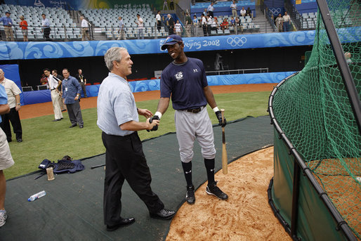 President George W. Bush meets with U.S. Olympic men's baseball team player Dexter Fowler of Alpharetta, Ga., while attending a practice game between the U.S. and the Chinese Olympic men's baseball teams Monday, Aug. 11, 2008, at the 2008 Summer Olympic Games in Beijing. White House photo by Eric Draper