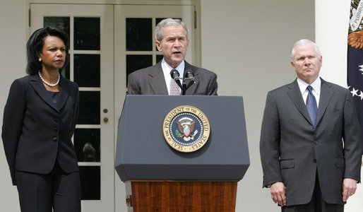 Flanked by U.S. Secretary of State Condoleezza Rice and U.S. Secretary of Defense Robert Gates, President George W. Bush delivers a statement in the Rose Garden Wednesday, Aug. 13, 2008, regarding efforts by the United States to resolve the crisis in Georgia. White House photo by Joyce N. Boghosian