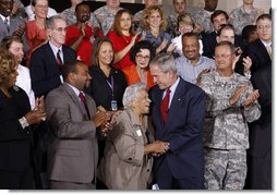 President George W. Bush embraces New Orleans chef and restaurant owner Leah Chase following his address Wednesday, Aug. 20, 2008 at the historic Jackson Barracks in New Orleans, where President Bush honored residents and community leaders for their determination to rebuild their communities three years after Hurricane Katrina devastated the Gulf Coast region. White House photo by Eric Draper