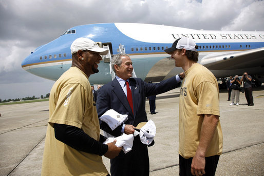 President George W. Bush is welcomed by New Orleans Saints running back Deuce McAllister, left, and Saints quarterback Drew Brees upon his arrival Wednesday, Aug. 20, 2008 to the Louis Armstrong International Airport in New Orleans. White House photo by Eric Draper
