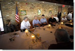 President George W. Bush is joined by Mississippi Governor Haley Barbour, second fromleft, and Gulfport, Miss., Mayor Brent Warr, right, Wednesday, Aug. 20, 2008 during a dinner with community leaders in Gulfport. Miss., to discuss the continued recovery efforts three years after Hurricane Katrina. White House photo by Eric Draper