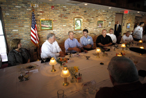 President George W. Bush is joined by Mississippi Governor Haley Barbour, second from left, and Gulfport, Miss., Mayor Brent Warr, right, Wednesday, Aug. 20, 2008 during a dinner with community leaders in Gulfport. Miss., to discuss the continued recovery efforts three years after Hurricane Katrina. White House photo by Eric Draper