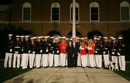 President and Mrs. Bush pose for a photograph with participants of the Evening Parade at the Marine Barracks Friday, August 29, 2008, in Washington DC. White House photo by Joyce N. Boghosian