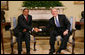 President George W. Bush shakes hands with Tanzania President Jakaya Kikwete in the Oval Office at the White House Friday, Aug. 29, 2008, during their meeting with reporters. White House photo by Chris Greenberg