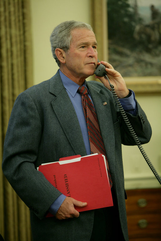 President George W. Bush calls Texas Governor Rick Perry, Saturday, Aug. 30, 2008, to discuss the impending storms that are expected to strike Texas and areas of the Gulf Coast region as a result of Hurricane Gustav. White House photo by Chris Greenberg