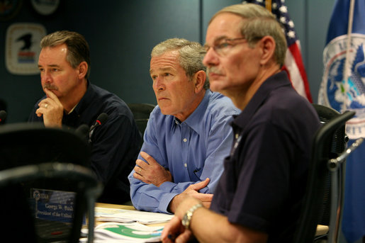 President George W. Bush, joined by Federal Emergency Management Agency Administrator David Paulison, left, and Deputy Administrator Harvey Johnson, right, participates in a briefing on preparations for Hurricane Gustav, at the FEMA National Response Center, Sunday, August 31, 2008 in Washington, DC. White House photo by Chris Greenberg