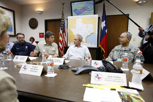President George W. Bush is joined by FEMA Administrator Secretary David Paulison, left, Texas Governor Rick Perry and Texas National Guard Lt. General Charles Rodriguez, right, during a briefing Monday, Sept. 1, 2008 at the Texas Emergency Operations Center in Austin, Texas, for the most recent update on Hurricane Gustav. White House photo by Eric Draper